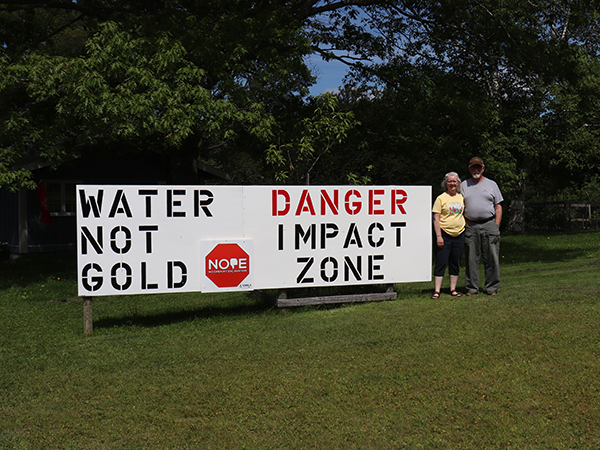 Ralph Jack and Gwyneth Boutilier live on Cumminger Lake, below a proposed Cochrane Hill gold mine site, so they make their feelings about gold mining known on their front lawn. - ANDREW BETHUNE
