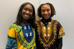 "Amariah Bernard (left) and Zamani Millar sang a moving rendition of ""O Canada"" and ""Lift Every Voice and Sing"" in front of the crowd. - THE COAST"