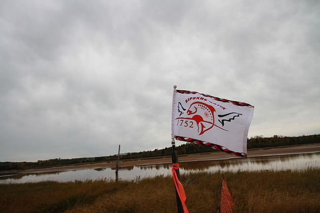 The Sipekne'katik flag waves at the proposed Alton Gas brine storage site. - TORI BALL