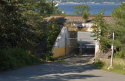 Don't be deceived, this rail bridge will soon lead you to a boozy outdoor oasis. - GOOGLE MAPS
