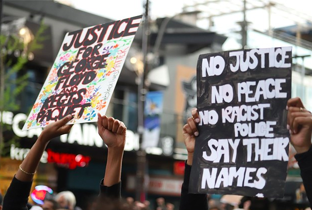 Signs at the June 2 Halifax protest for George Floyd, whose death at the hands of Minneapolis police has four officers charged with murder. - VICTORIA WALTON