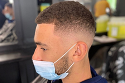 A fresh cut at Ascension in the new normal involves a mask for both client and barber - ASCENSION BARBERS