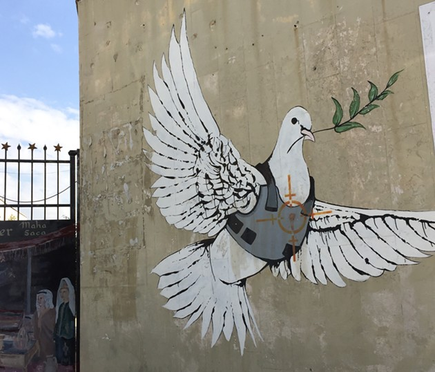 This photo was taken of a Banksy piece in Bethlehem on the separation apartheid wall that runs across the 1967 borders. - SUBMITTED