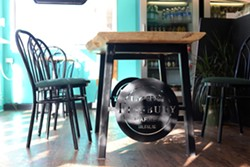 Finsbury's logo custom-made into the legs of a table in their brand new seating area. - VICTORIA WALTON