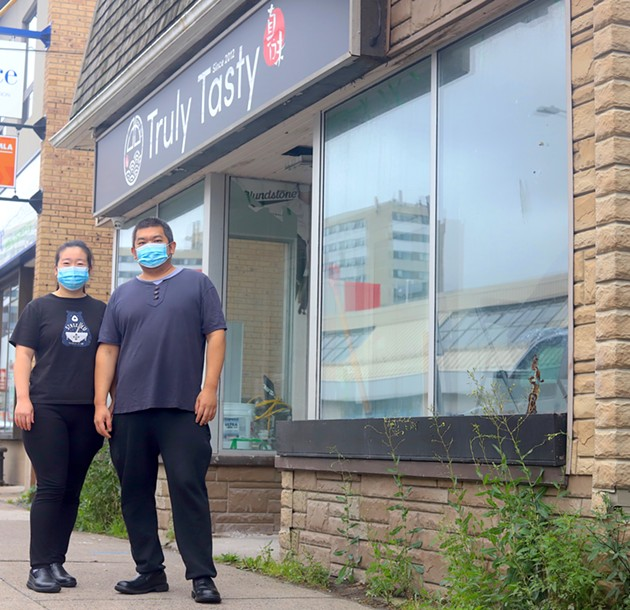 Shanshan Liu and Jian Li stand outside their new, bigger Truly Tasty, which is set to open Oct 23. - VICTORIA WALTON