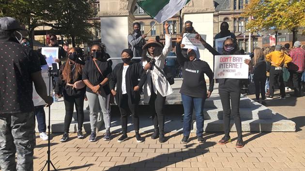Protesters at Halifax's Grand Parade calling to #ENDSARS. - SEYITAN MORITIWON