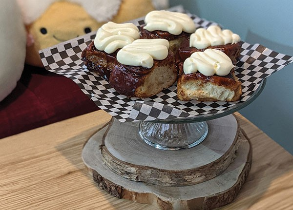 Tart & Soul's cinnamon buns have a hefty helping of cream cheese icing on top. - SUBMITTED