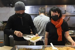 Yi Chiao and Pi Yeng Chen have served food at the market for more than three decades. - VICTORIA WALTON