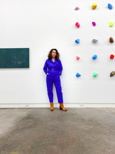 Artist Emily Falencki, founder and director of The Blue Building gallery, stands inside the space, next to works by gallery artist Lucy Pullen. - RYAN JOSEY