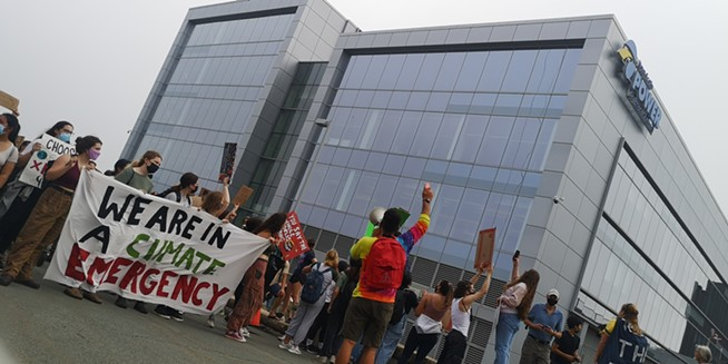 Protesters stayed for about ten minutes in front of the Nova Scotia Power headquarters by the Halifax waterfront, chanting against the privately owned electricity provider. - ORIOL SALVADOR/THE COAST