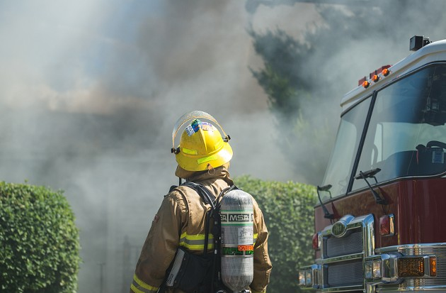 A Halifax Regional Fire and Emergency service firefighter monitors the progress on the scene of a stubborn house fire in 2012. - VIA SHAUN LOWE