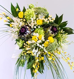 """""""What is traditional any more? """" says Korayne Romanchuk, who designed this bouquet. - JESSICA JUDGE"""