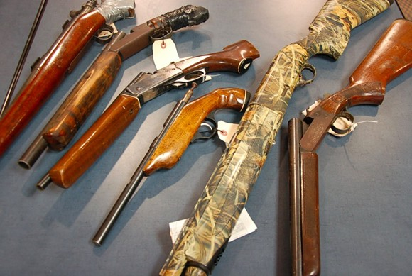 Assorted rifles and shotguns that have been confiscated by police. - THE COAST