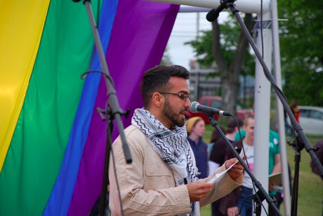 Queer and Muslim speaker Ayman (who preferred not to give his last name) speaks to the crowd about islamophobia, peace and love. - THE COAST
