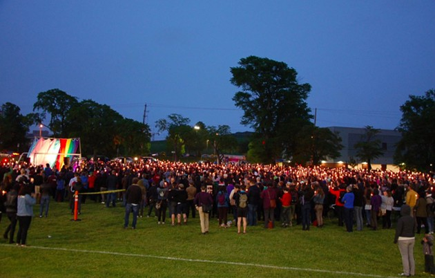 Candles raised during Monday's vigil. - THE COAST