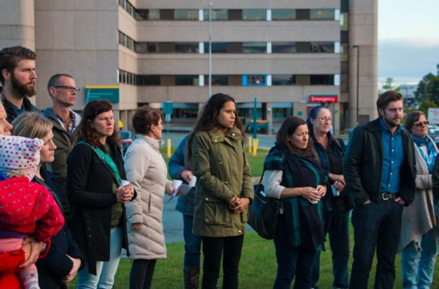 Jones (centre) leads protesters at the rally outside the Dartmouth General on Thursday evening. - KIERAN LEAVITT