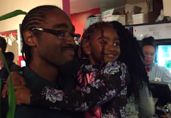 Lindell Smith poses with his daughter while watching the election results come in. - VIA ALEXANDER QUON