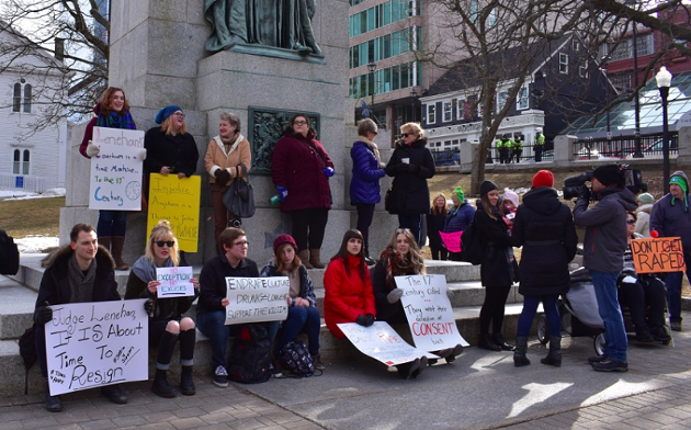 Members of the public gathered to protest judge Lenehan's acquittal of Bassam Al-Rawi earlier this week at Grand Parade. - THE COAST