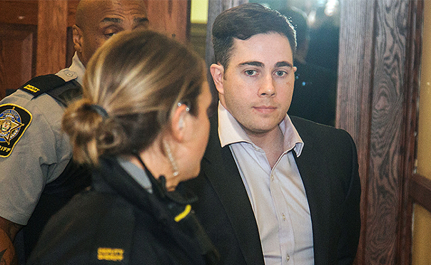Christopher Garnier being escorted from court, in 2016. - THE COAST