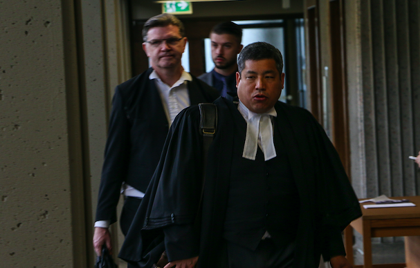Defence lawyers Eugene Tan (front) and Brad Sarson walk into court on May 24. - KIERAN LEAVITT