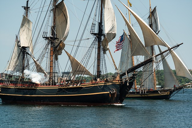 The Bounty and Pride of Baltimore sail past the Halifax waterfront with a cannon salute during the parade of sail marking the end of the Tall Ships festival in 2012. - VIA ISTOCK