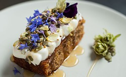 Carrot cake with candied hops, lavender goat cheese icing, burnt honey, bee pollen and pumpkin seeds. - JESSICA EMIN