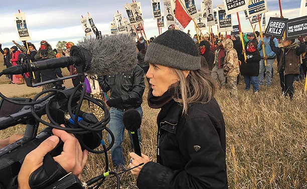 Amy Goodman covering the Standing Rock water protection actions in October 2016. - REED BRODY