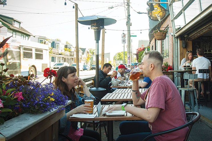 To help restaurants out, city council might kick fees for sidewalk patios to the curb. LENNY MULLINS
