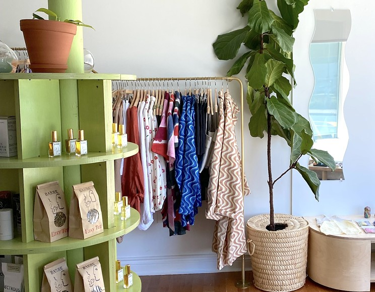 Slowly Slowly's charming interior features a brass clothing rack by Sarah Sears, sister of owner Hannah Sears.