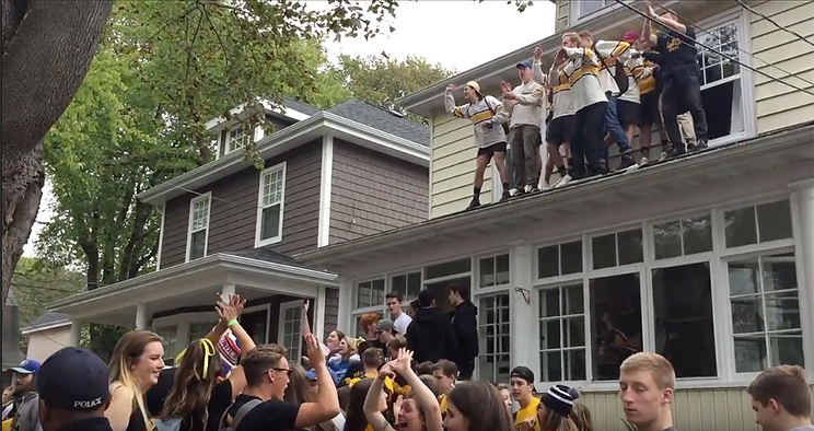The party overflowed from the streets up onto the roofs of some houses.