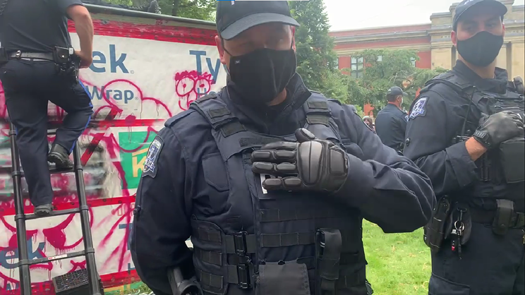 """The petition lists several concerns, including reports of """"some police officers removing name tags"""" during the shelter siege at the old Halifax Memorial Library on August 18."""