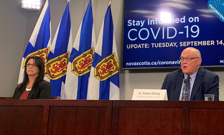 Health minister Michelle Thompson, left, at her first COVID briefing with top doc Strang, says the fourth wave is officially in Nova Scotia.