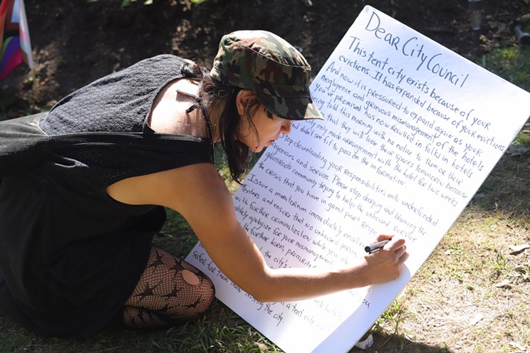 Rachelle Sauvé writes a letter to the city on behalf of people with no safe place to sleep Wednesday night.