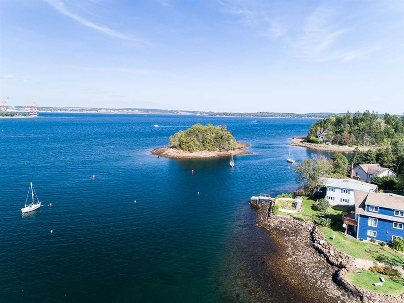 This undeveloped island can be yours for a cool $300,000. - VIA HARBOURSIDE REALTY
