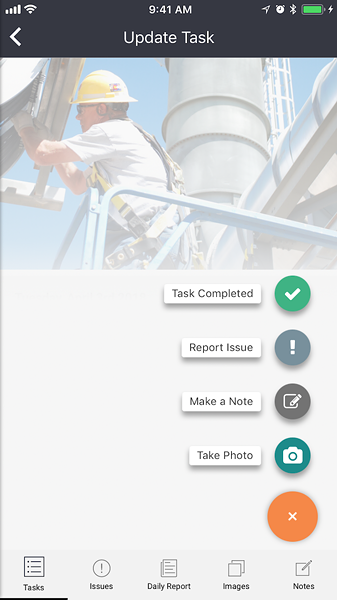 On a construction site, the site manager makes progress reports through Harbr's phone app. - SCREENSHOT