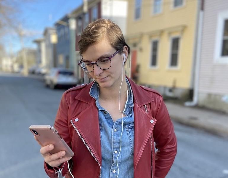A Vista20 user tapping her way through the app-slash-play. - ALEX MCLEAN PHOTO