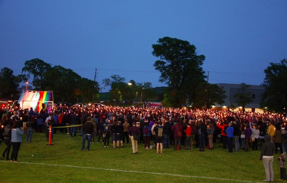 Candles raised during Monday's vigil. - THE COAST