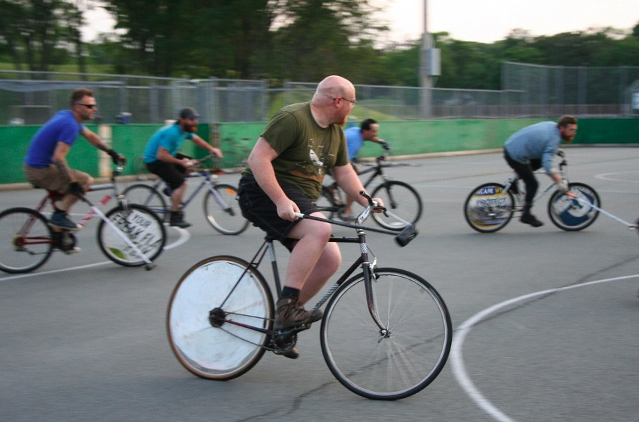 Jeff Mitchell, Leila Kadivar, Curtis Cando and a man known only as Danger play some bike polo - JONATHAN BRIGGINS