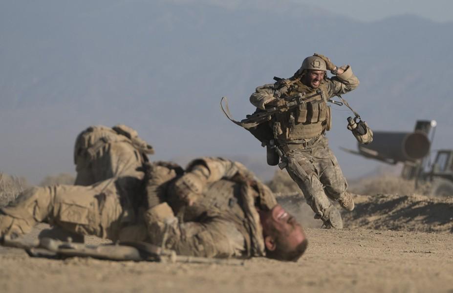Aaron Taylor-Johnson and a (spoiler alert) gunned-down John Cena. - VIA IMDB