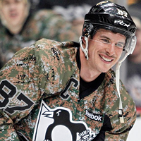 Pittsburgh Penguins captain Sidney Crosby wearing a camo jersey to honour military veterans during a hockey game last November.