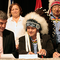 Premier Stephen McNeil, Chief Leroy Denny and Chief Robert Gloade sign a memorandum of understanding on treaty education in 2015.