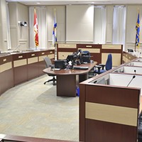 Council chambers, pictured during one of its brief quiet moments.
