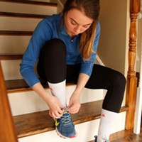 Lauren Goodyear laces up her shoes for a run.