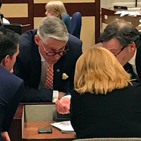 CAO Jacques Dubé (centre left) consults with planning staff and legal director John Traves in the middle of Tuesday's meeting.