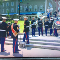 """""""U-S Marines Band walking away after protesters shout them down at Grande Parade,"""" reads Ron Shaw's tweet. """"Never played their outdoor concert here."""""""