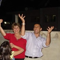 Andrew and Rajaa Al-Khouri dance on a rooftop in Syria