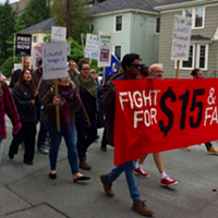 Protesters calling for a $15/hour minimum wage take to the streets back in October.