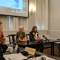 Joanne Bealy and Nancy Hunter (right) present The Coalition to Ban Street Checks' petition for the province to Halifax's Board of Police Commissioners.