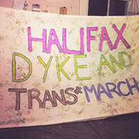 A banner from a previous Dyke and Trans March in Halifax