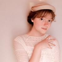 Ella MacDonald as Carrie Stettheimer.